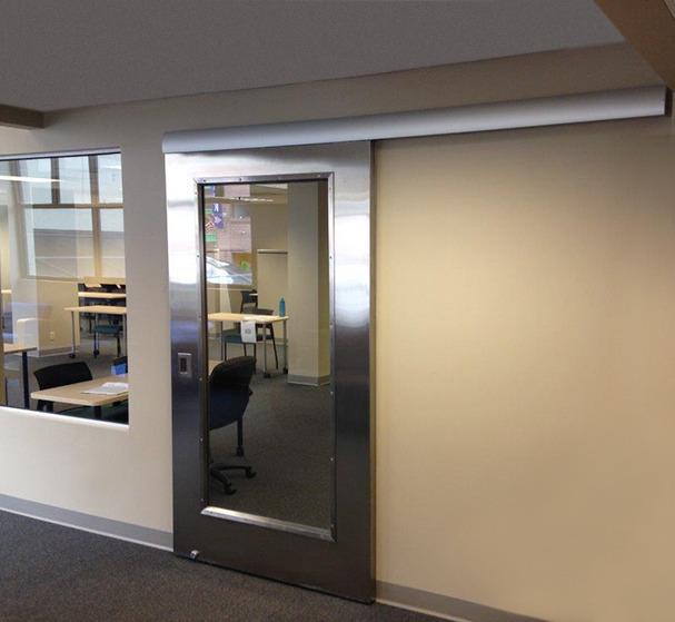 Gentil Wall Mounted Doors Save Space Over Traditional Swing Out Doors And Give  This Office A Sleek Look.